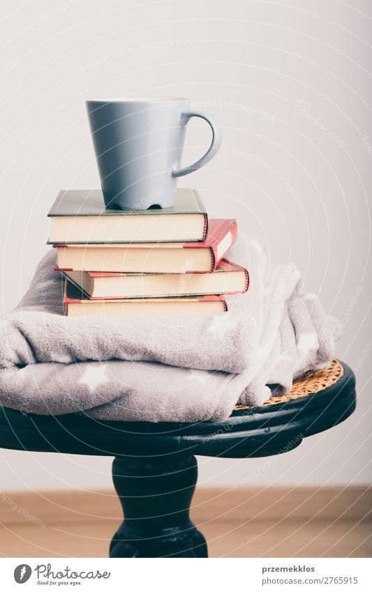 A few books with cup of coffee and blanket on wooden chair Coffee Mug Lifestyle Relaxation Leisure and hobbies Reading Chair Book To enjoy Safety (feeling of)