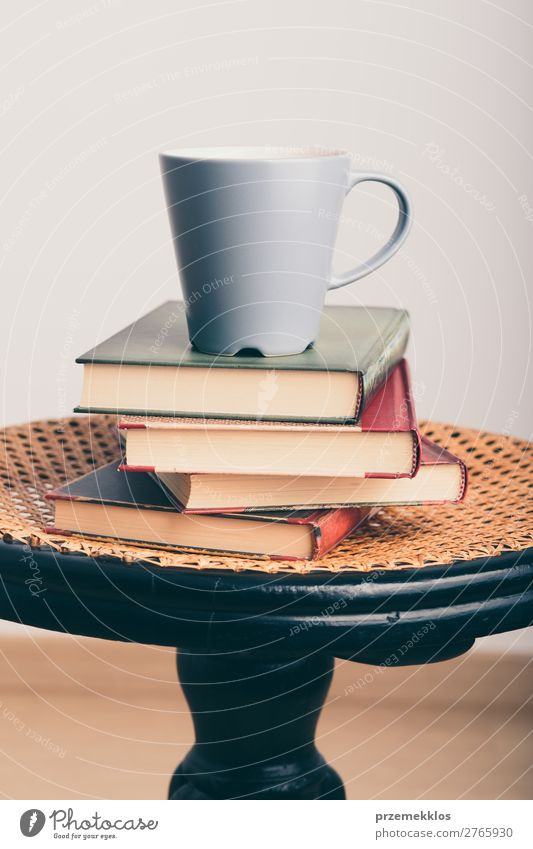 A few books with cup of coffee on chair Coffee Mug Lifestyle Relaxation Leisure and hobbies Reading Chair Table Book To enjoy Brown Safety (feeling of)