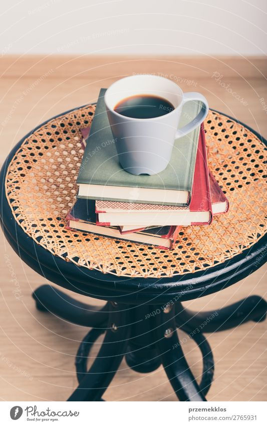 A few books with cup of coffee on chair Coffee Mug Lifestyle Relaxation Leisure and hobbies Reading Chair Table Book To enjoy Safety (feeling of) Comfortable