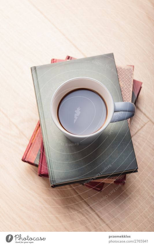 A few books with cup of coffee on wooden floor Coffee Mug Lifestyle Relaxation Leisure and hobbies Reading Chair Table Book To enjoy Safety (feeling of)