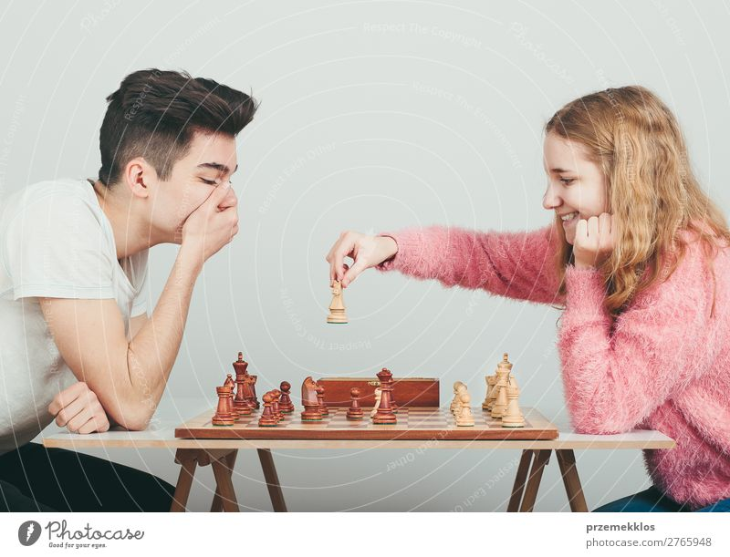 Checkmate. Lifestyle Leisure and hobbies Playing Chess Success Human being Boy (child) Woman Adults Man To enjoy Smart Black White Determination Battle beat