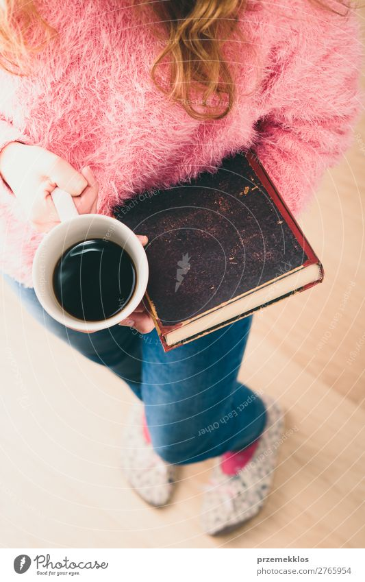 Girl holding book and cup of coffee going to relax with a book Coffee Lifestyle Relaxation Leisure and hobbies Reading Child Human being Woman Adults Book