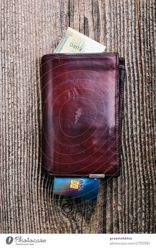Leather wallet with euro banknotes, credit card on wooden desk Money Table Success Financial Industry Wood Above Brown Bank note Card cash debit