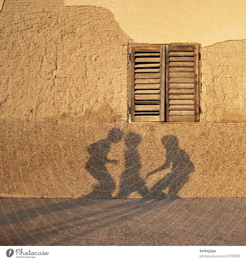 Human being House (Residential Structure) Playing Boy (child) Group Facade Leisure and hobbies Group of children Plaster Shutter Children's game Shadow play
