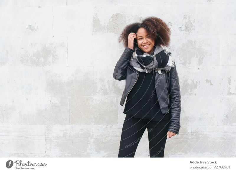 Smiling woman in leather jacket Woman Concrete Wall (building) Youth (Young adults) Attractive Human being Fashion Style Design Easygoing Blank Wear Clothing