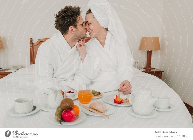 Couple having breakfast in hotel Eating Breakfast Together Room service Bathrobe Hotel Bedroom Home Interior design Furniture Flat (apartment) Design