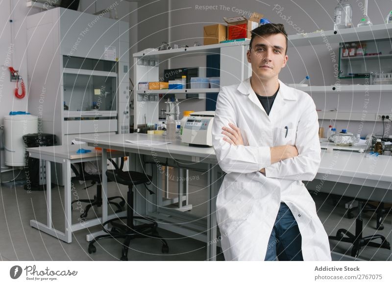 Young man in lab Laboratory Work and employment Science & Research Man Human being Looking into the camera