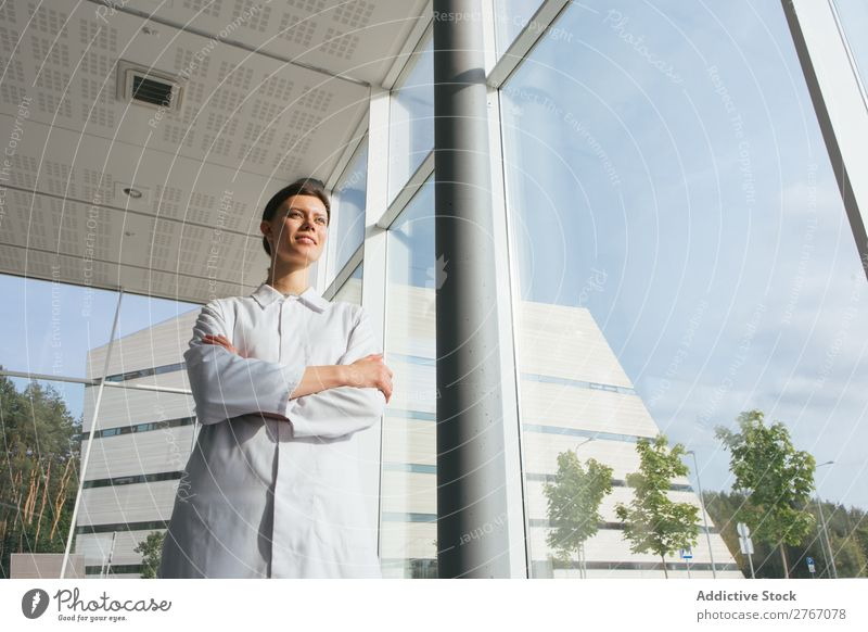 Woman in whites at modern building Laboratory Work and employment Science & Research Building Modern Contemporary Human being