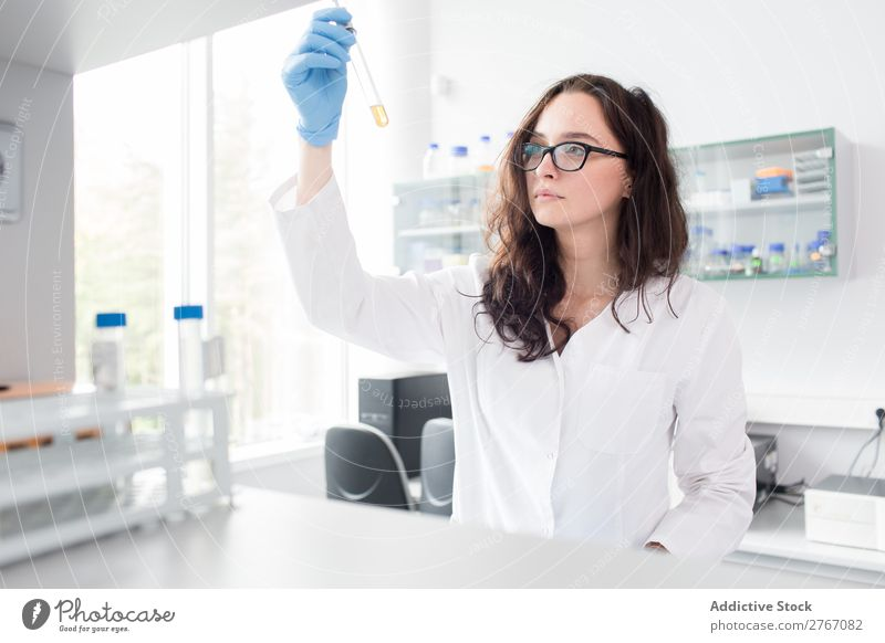 Woman looking at test tube Laboratory Work and employment Science & Research Test tube Reaction Observe Human being