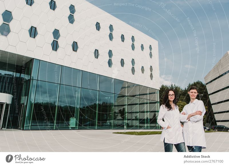 Women in whites at modern building Laboratory Work and employment Science & Research Woman Building Modern Contemporary Human being