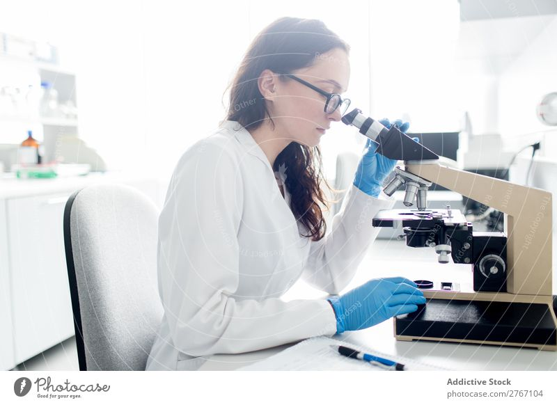 Woman looking at microscope Laboratory Work and employment Science & Research Microscope Observe Human being