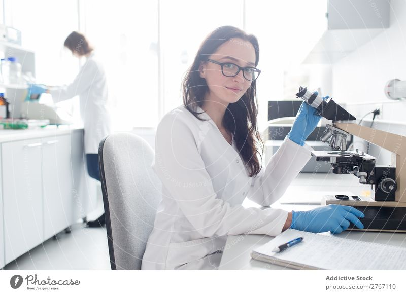 Woman working with microscope Laboratory Work and employment Science & Research Microscope Observe Human being