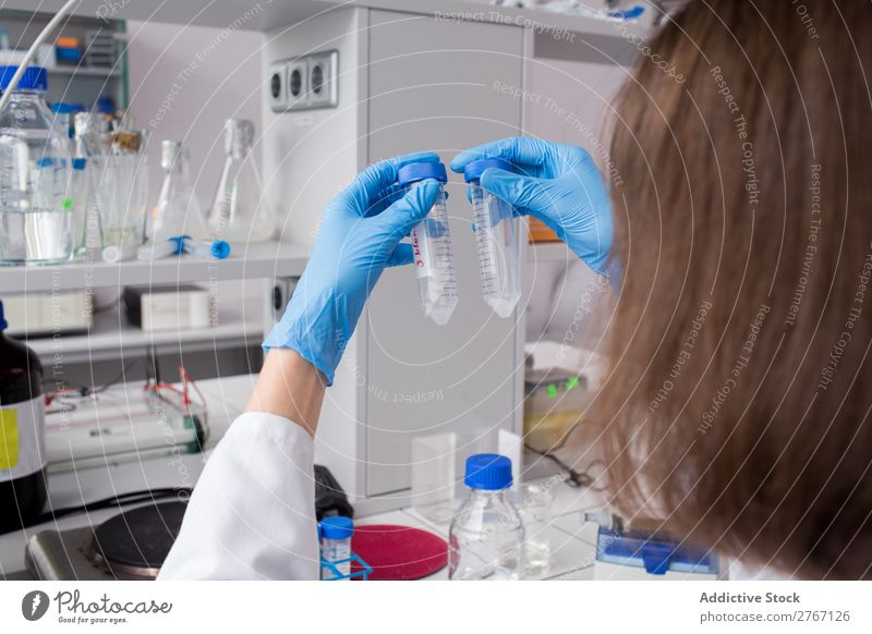 Worker watching test tubes Laboratory Work and employment Science & Research Woman Test tube Liquid Putt Human being