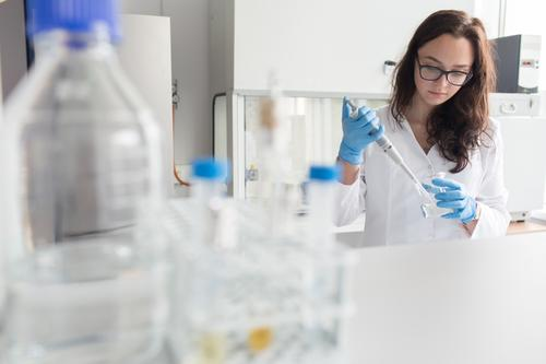Woman holding flask in lab Laboratory Work and employment Science & Research Erlenmeyer flask Glass Scientist Medication Chemistry Technology Doctor experiment