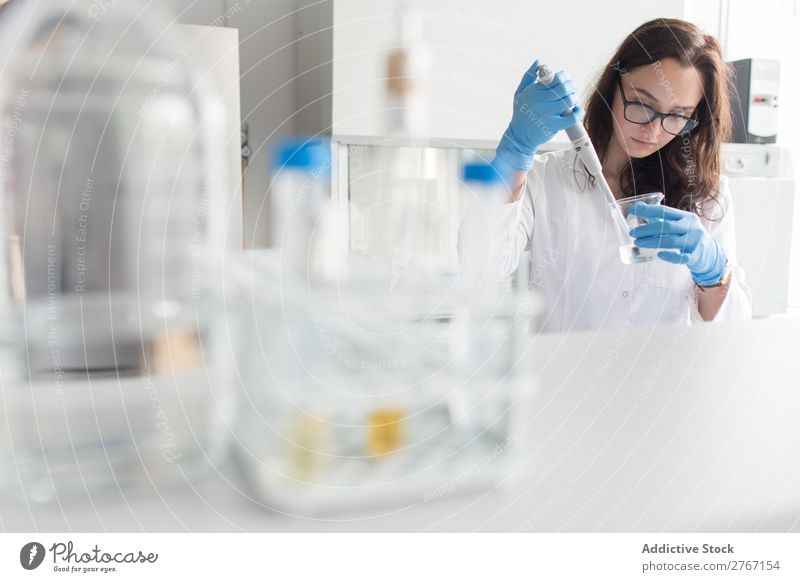 Woman holding flask in lab Laboratory Work and employment Science & Research Erlenmeyer flask Glass Scientist