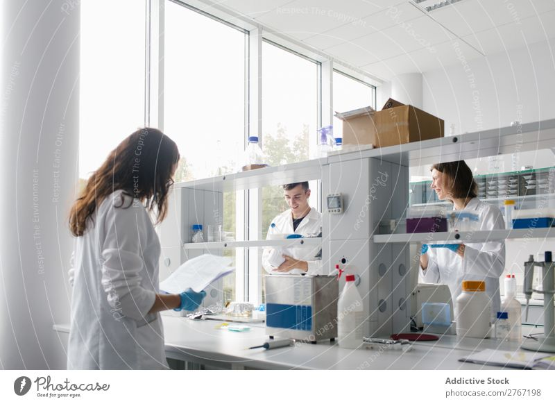 People co-working in lab Laboratory Work and employment Science & Research Woman Man Human being