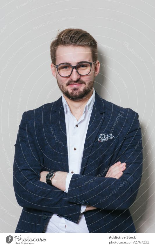 Young stylish man at white wall Man Suit Style handsome arms crossed Person wearing glasses Wall (building) Fashion Youth (Young adults) Portrait photograph