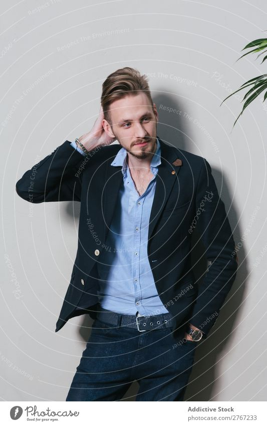 Young stylish man at white wall Man Suit Style handsome Plant potted Wall (building) Fashion Youth (Young adults) Portrait photograph Successful Human being