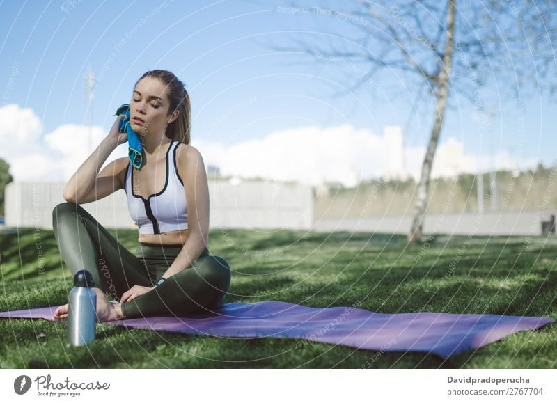 Woman resting and drinking water with towel after workout Lifestyle Beautiful Body Relaxation Meditation Sports Yoga Human being Adults Nature Warmth Park