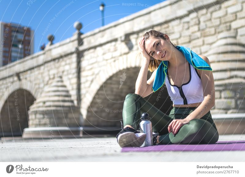 Woman relaxing and drinking water with towel after workout Lifestyle Beautiful Body Relaxation Meditation Sports Yoga Human being Adults Nature Warmth Park