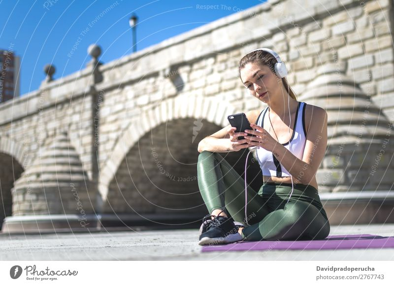 Woman resting and listening music with mobile while working out Lifestyle Beautiful Wellness Relaxation Meditation Music Sports Yoga Human being Adults Nature