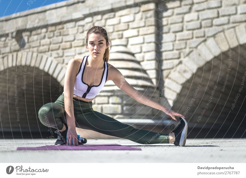 woman doing yoga and pilates outdoor with her mat Lifestyle Beautiful Body Relaxation Meditation Sports Yoga Human being Woman Adults Nature Warmth Park