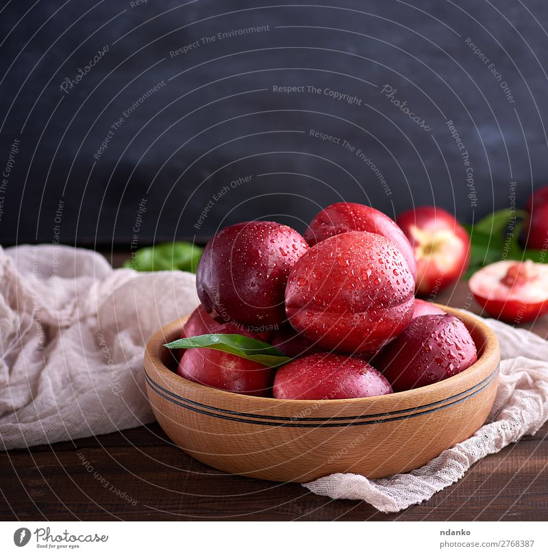 ripe peaches nectarine in a brown wooden bowl Summer Red Leaf Black Eating Wood Natural Copy Space Group Brown Fruit Nutrition Fresh Table Delicious Dessert