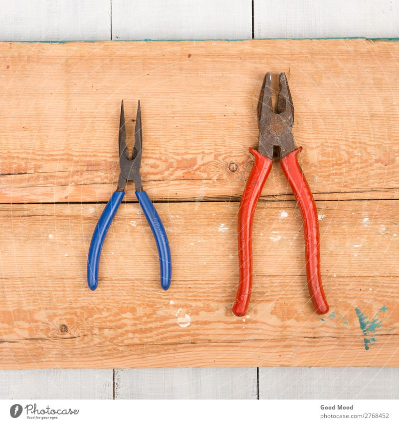 Old pliers on wooden background Table Work and employment Industry Tool Wood Metal Steel Rust Build Dirty Ancient board Carpenter carpentry Conceptual design