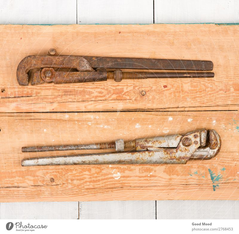 adjustable wrenchs on wooden background Work and employment Industry Tool Wood Metal Steel Rust Old Build Idea Ancient Bench construction equipment Story Grunge