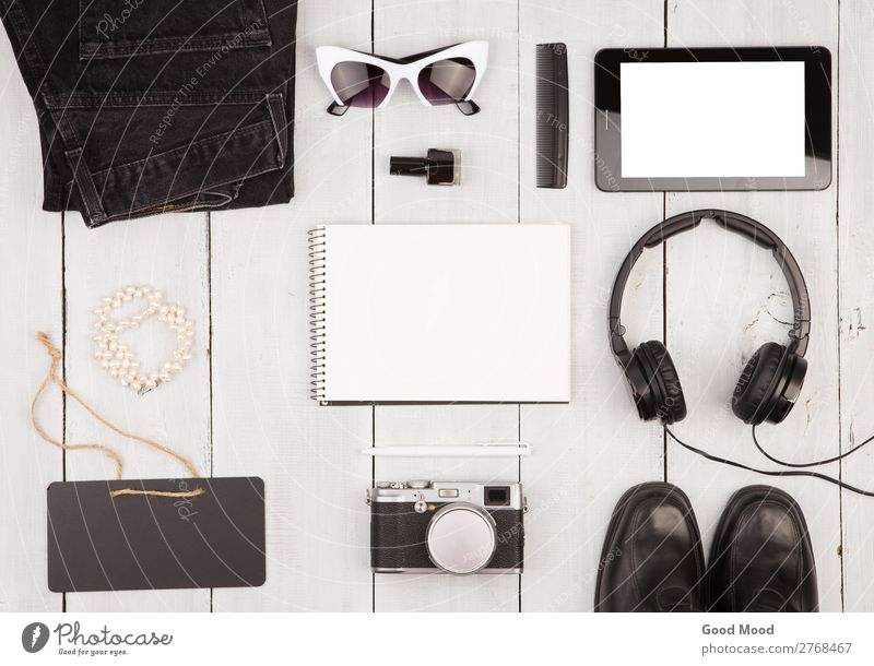 shoes, jeans, tablet pc, camera, headphones, notepad Lifestyle Shopping Style Vacation & Travel Trip Blackboard Business Meeting Computer Camera Woman Adults
