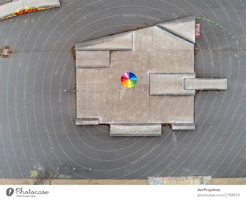 Umbrella on grey surface Leisure and hobbies Playing Vacation & Travel Safari Sporting Complex Capital city Playground Stone Observe Communicate Esthetic