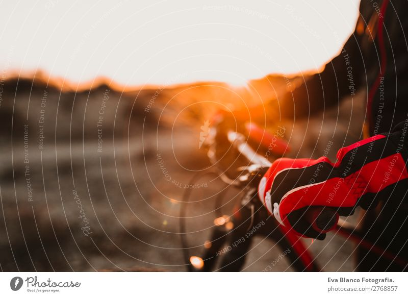 close up view of a Cyclist equipment and handlebar. Human being Sky Nature Youth (Young adults) Man Summer Young man Landscape Red Sun Relaxation Joy Winter