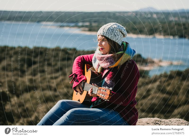 Woman playing guitar outdoors. Lifesytle Lifestyle Joy Happy Relaxation Leisure and hobbies Playing Vacation & Travel Winter Music Human being Feminine Adults