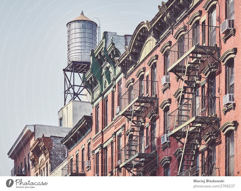 Water tank and fire escapes in downtown New York. Old House (Residential Structure) Architecture Wall (building) Style Building Wall (barrier) Facade