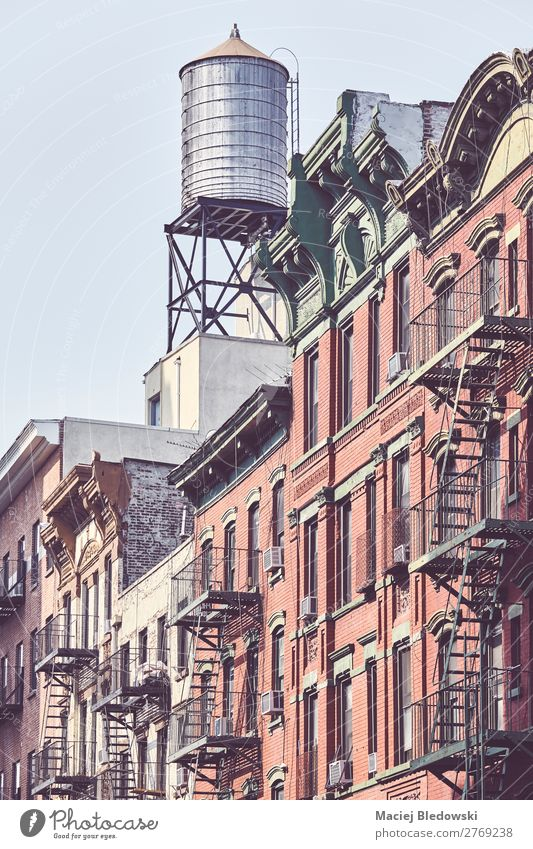 Water tank and fire escapes in downtown New York. Old Town House (Residential Structure) Architecture Building Time Facade Living or residing Flat (apartment)