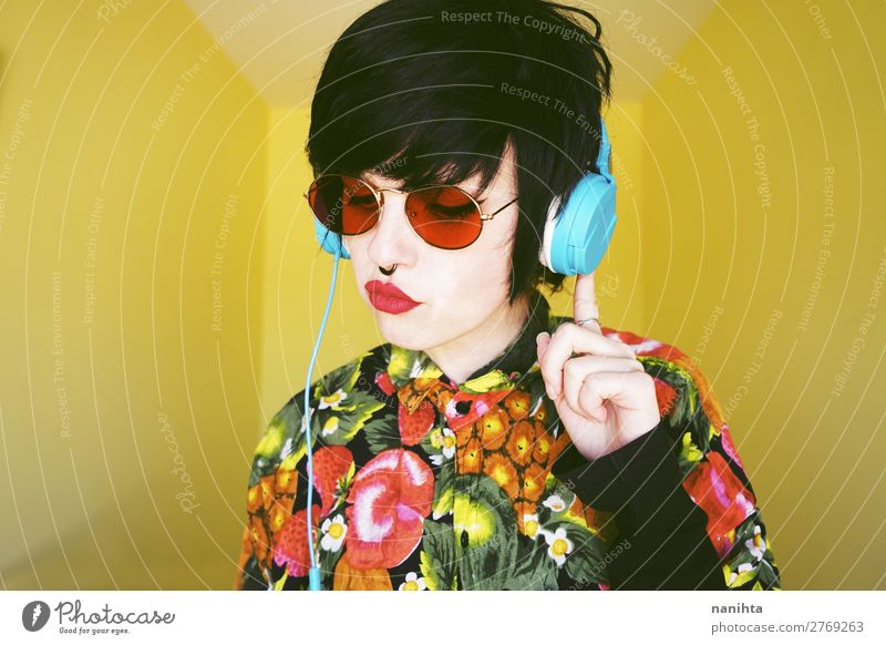 Cool androgynous dj woman in vibrant colors Woman Human being Youth (Young adults) Summer Colour 18 - 30 years Adults Yellow Feminine Party Fashion