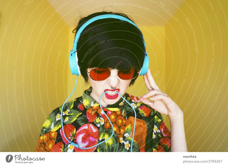 Cool androgynous dj woman in vibrant colors Style Design Hair and hairstyles Summer Party Music Disc jockey Headset Technology Entertainment electronics