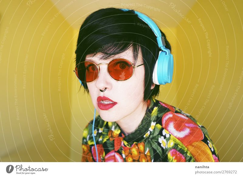 Cool androgynous dj woman in vibrant colors Hair and hairstyles Summer Music Disc jockey Headset Technology Entertainment electronics Human being Feminine