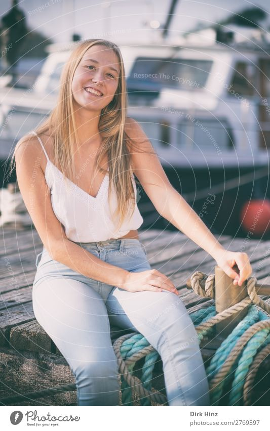 Young woman on a jetty Joy Summer Feminine Girl Youth (Young adults) Sister Family & Relations Friendship 1 Human being 18 - 30 years Adults Harbour Love Blonde