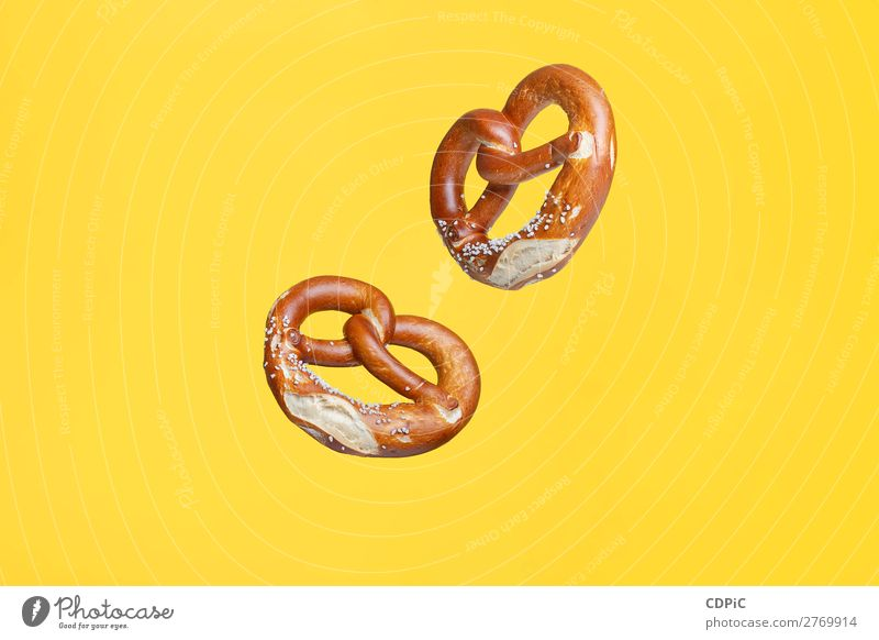 Flying Food Concept German Traditional Salted Pretzel Bread Fresh Delicious Soft bretzel market background Salty eat Snack salt pretzels Baked goods german
