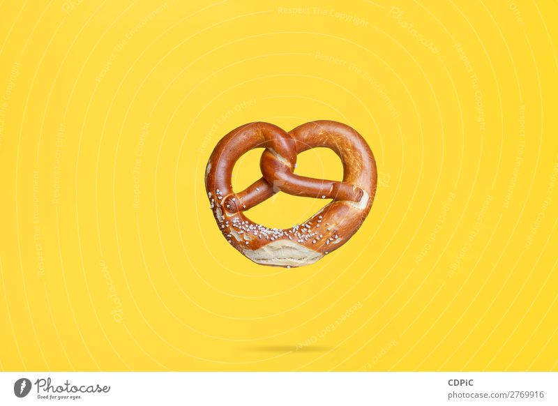 Flying Food Concept German Traditional Salted Pretzel Bread Fresh Delicious Soft bretzel market background food Salty eat Snack salt pretzels Baked goods german