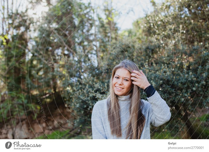 Young woman in the nature Lifestyle Joy Happy Beautiful Face Calm Winter Christmas & Advent Human being Woman Adults Nature Tree Park Forest Fashion Blonde