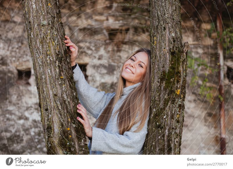 Beautiful woman next to the trunk of a tree Lifestyle Happy Face Freedom Summer Human being Woman Adults Nature Autumn Wind Tree Park Forest Fashion Blonde