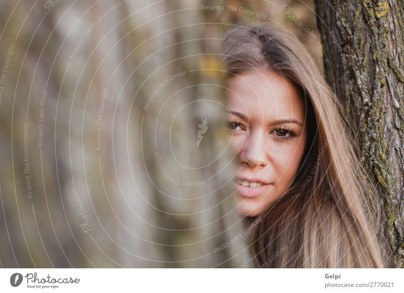 Beautiful woman behide to athe trunk of a tree Lifestyle Happy Face Freedom Summer Sun Human being Woman Adults Nature Autumn Wind Tree Park Forest Fashion