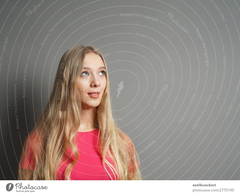 young woman looks up at the text space Human being Feminine Young woman Youth (Young adults) Woman Adults 1 13 - 18 years 18 - 30 years Wall (barrier)