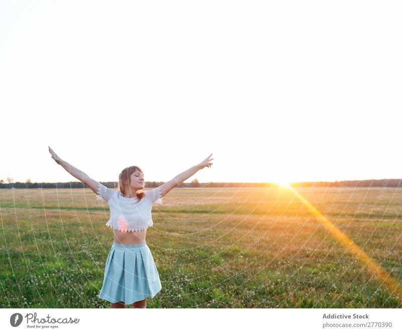 Woman posing in field Freedom Field Sunset romantic Posture Nature Dream Landscape Energy Style hands apart Relaxation To enjoy Harmonious Meditation