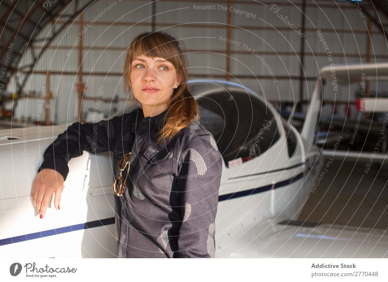 Girl posing in hangar Woman Hangar Airplane Posture Aviation Engineer Maintenance Freedom Transport Youth (Young adults) Leisure and hobbies Self-confident