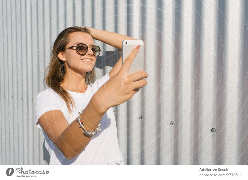 Youngster taking selfie at street Woman Town PDA Relaxation Self-confident Style Posture Summer Street Technology Leisure and hobbies youngster Connection