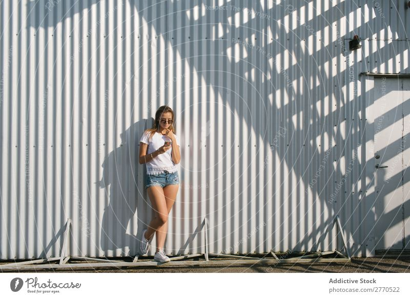 Youngster posing with smartphone at street Woman Town PDA Relaxation Self-confident Style Posture Summer Street Technology Leisure and hobbies youngster