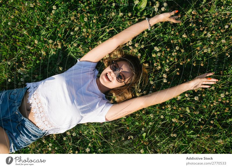 Confident girl posing in green field Woman Field Lie (Untruth) Cheerful Posture Happiness Easygoing Freedom Nature Summer Landscape Meadow romantic Fresh Dream